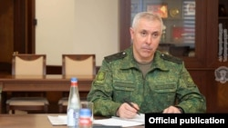 Armenia -- Lieutenant-General Rustam Muradov, the commander of Russian peacekeepering forces stationed in Nagorno-Karabakh, meets with Armenian Defense Minister Vagharshak Harutiunian, Yerevan, February 10, 2021.