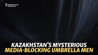 Kazakhstan's Mysterious Media-Blocking Umbrella Men