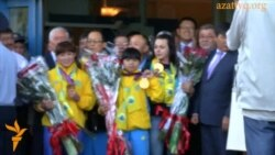 «Золотые штангистки» прилетели в Алматы