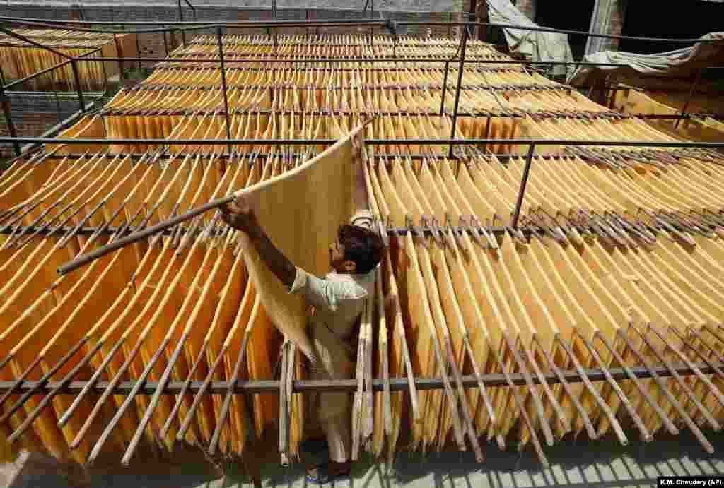A vendor arranges traditional vermicelli noodles at a factory in Lahore, Pakistan. (AP/K.M. Chaudary)
