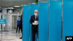 Kazakh President Qasym-Zhomart Toqaev voting during Kazakhstan's parliamentary elections in Nur-Sultan on January 10.