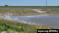 Озеро наповнене сміттям полігону ТПВ