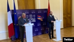 Armenia - French Senate speaker Gerard Larcher (L) speaks at a joint news conference with Armenian parliament speaker Ararat Mirzoyan, Yerevan, April 24, 2021.