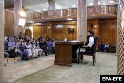 Taliban spokesman Zabihullah Mujahid talks with journalists during a press conference in Kabul on September 6.