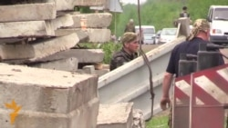 Sabotage Claims As Ukrainian Town Prepares Defenses