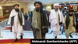 Taliban co-founder Mullah Abdul Ghani Baradar (C) and other members of the Taliban delegation arrive to attend a conference on Afghanistan in Moscow on March 18.