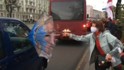 Protesting Pensioners In Minsk Fend Off Pepper Spray With Umbrellas