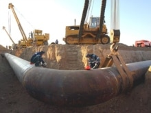 Gazprom welders work at the pipe during the construction works on the pipeline Middle Asia - Center in Aleksandrov Gai village at the border between Kazakhstan and Russia, 13Sep2007